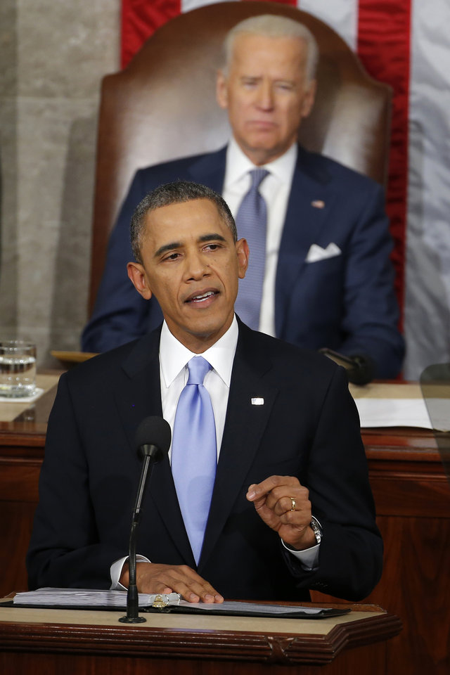 Photo - Vice President Joe Biden listens as President Barack Obama gives his State of the Union address on Capitol Hill in Washington, Tuesday Jan. 28, 2014. (AP Photo/Charles Dharapak)