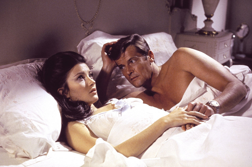 "This undated publicity photo provided by United Artists and Danjaq, LLC shows jane Seymour, left, and Roger Moore, in the James Bond 1973 film, ""Live and Let Die."" Initially, Bond girls were part of the aesthetic of the series. They had more transient roles. The film is included in the MGM and 20th Century Fox Home Entertainment Blu-Ray ""Bond 50"" anniversary set. (AP Photo/United Artists and Danjaq, LLC)"