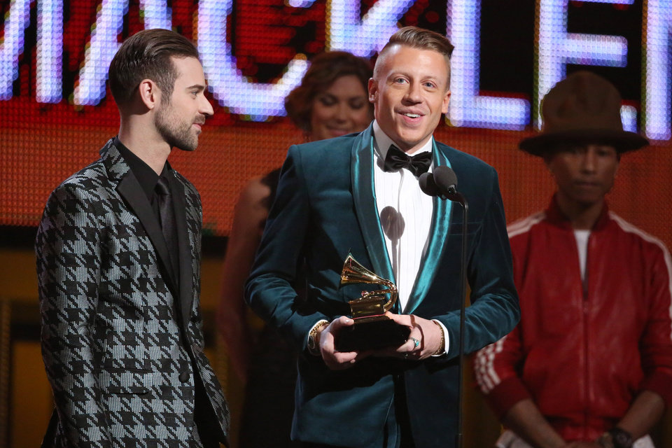 Photo - Ryan Lewis, left, and Macklemore accept the award for best new artist at the 56th annual Grammy Awards at Staples Center on Sunday, Jan. 26, 2014, in Los Angeles. (Photo by Matt Sayles/Invision/AP)