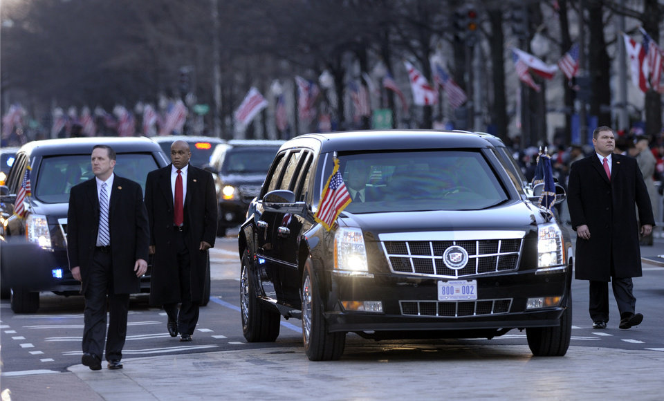 Photo - The presidential limousine with President Barack Obama and first lady Michelle Obama inside, heads down Pennsylvania Avenue in the Inaugural Parade after the ceremonial swearing-in for the 57th Presidential Inauguration on Capitol Hill in Washington, Monday, Jan. 21, 2013. (AP Photo/Susan Walsh) ORG XMIT: DCSW103