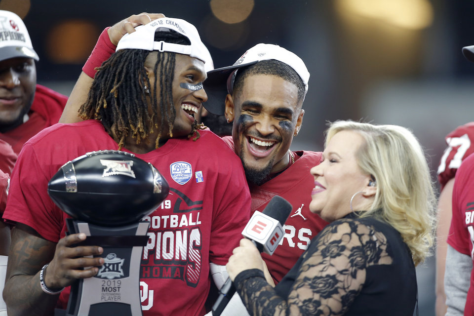 Photo - Oklahoma's CeeDee Lamb, left, and Jalen Hurts smile as they are interviewed by ESPN's Holly Rowe following Big 12 Championship Game between the University of Oklahoma Sooners (OU) and the Baylor University Bears at AT&T Stadium in Arlington, Texas, Saturday, Dec. 7, 2019. Oklahoma won 30-23. [Bryan Terry/The Oklahoman]