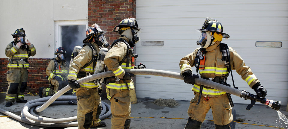 Photo - Oklahoma City firefighters practice attacking a fire with large hoses during recent training.