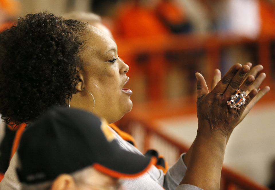 Samatha Nash, mother of OSU player Le'Bryan Nash, cheers during a men's college basketball game between Oklahoma State University and the University of Texas at Gallagher-Iba Arena in Stillwater, Okla., Saturday, March 2, 2013. OSU won, 78-65. Photo by Nate Billings, The Oklahoman