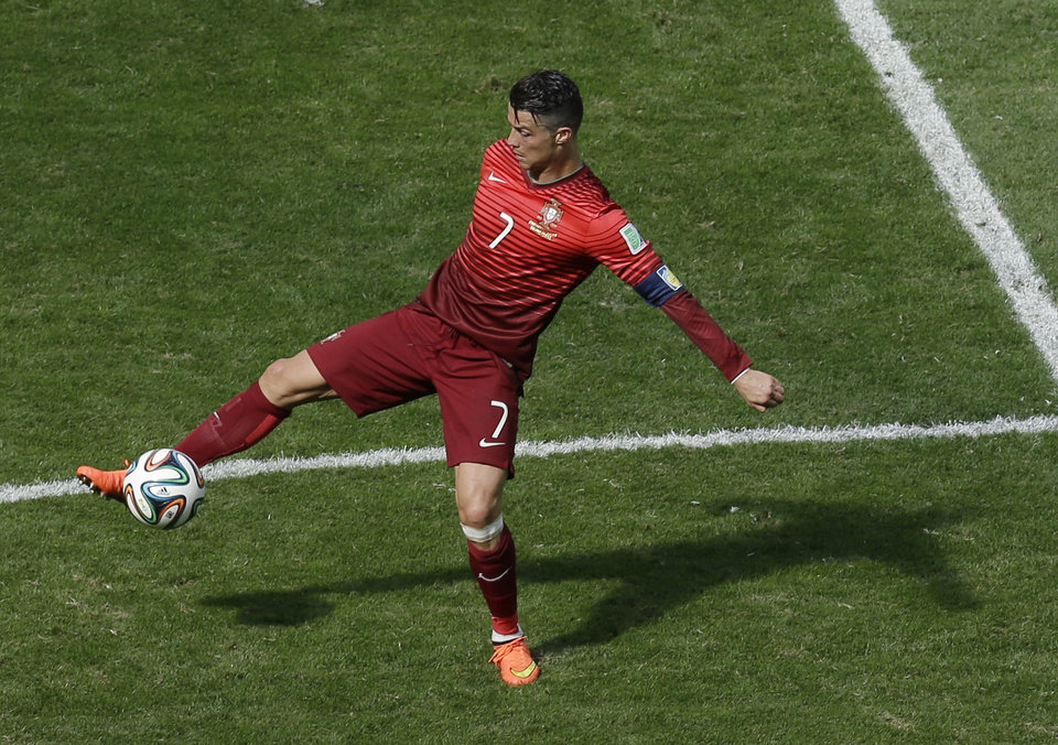 Photo - Portugal's Cristiano Ronaldo controls the ball during the group G World Cup soccer match between Portugal and Ghana at the Estadio Nacional in Brasilia, Brazil, Thursday, June 26, 2014. (AP Photo/Themba Hadebe)