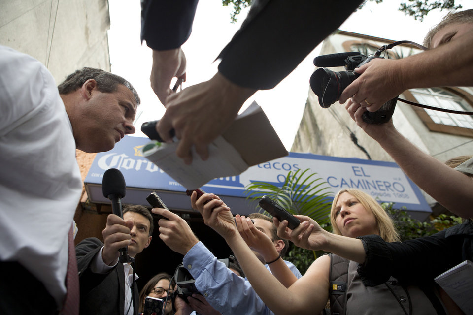 Photo - New Jersey Gov. Chris Christie answers questions from the traveling press as he arrives to have lunch at Tacos El Caminero in Mexico City, Thursday, Sept. 4, 2014. The potential 2016 U.S. presidential contender has called his three-day trade mission to Mexico a learning opportunity. (AP Photo/Rebecca Blackwell)
