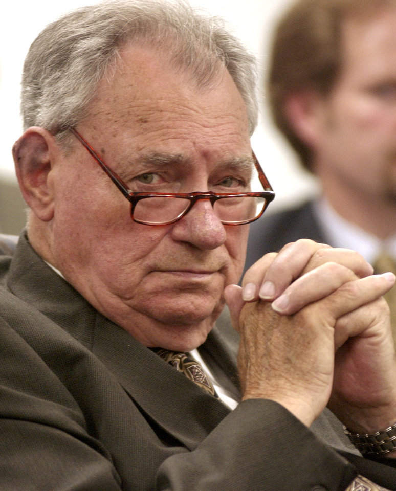 Photo - Oklahoma City, OK. 5/20/04 Retired state Senator Gene Stipe listens to arguments as the Oklahoma Public Employees Retirement Board decides the fate of his state pension. Staff photo by Paul Hellstern.