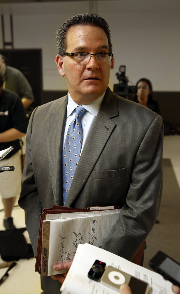 Photo - CHRISTOPHER LANE MURDER / CHRISTOPHER HICKS: District Attorney Jason M. Hicks answers reporter's question after three teenage suspects were arraigned in the shooting death of Christopher Lane on Tuesday, Aug. 20, 2013 in Duncan, Okla.  Photo by Steve Sisney, The Oklahoman