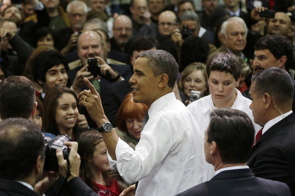 President Barack Obama greets audience members after speaking during a visit Linamar Corporation in Arden, N.C., Wednesday, Feb. 13, 2013, the day after delivering his State of the Union address. (AP Photo/Charles Dharapak)