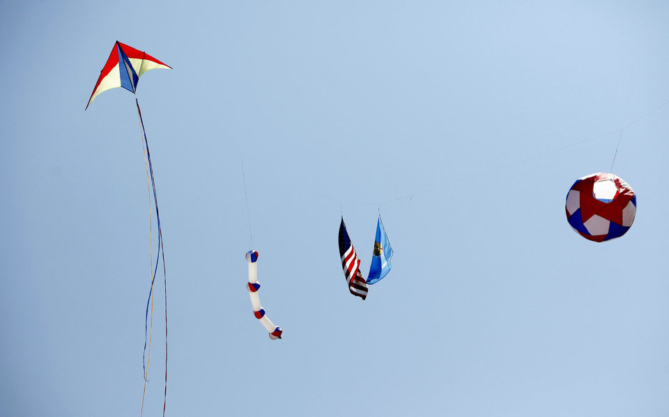 Photo - Numerous kites fly in the sky Saturday during KiteFest at Mitch Park.