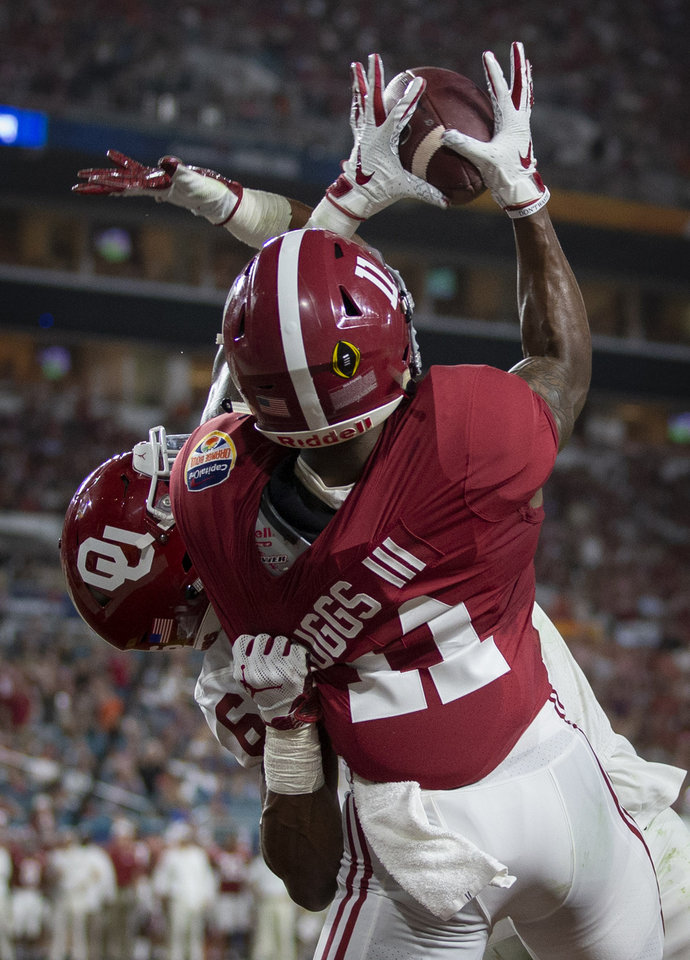 Photo - Alabama Crimson Tide wide receiver Henry Ruggs III (11) pulls in a touchdown pass over Oklahoma Sooners cornerback Tre Brown (6) in the first quarter in the College Football Playoff semifinals in the Orange Bowl at Hard Rock Stadium in Miami Gardens, Florida on December 29, 2018. [ALLEN EYESTONE/palmbeachpost.com]