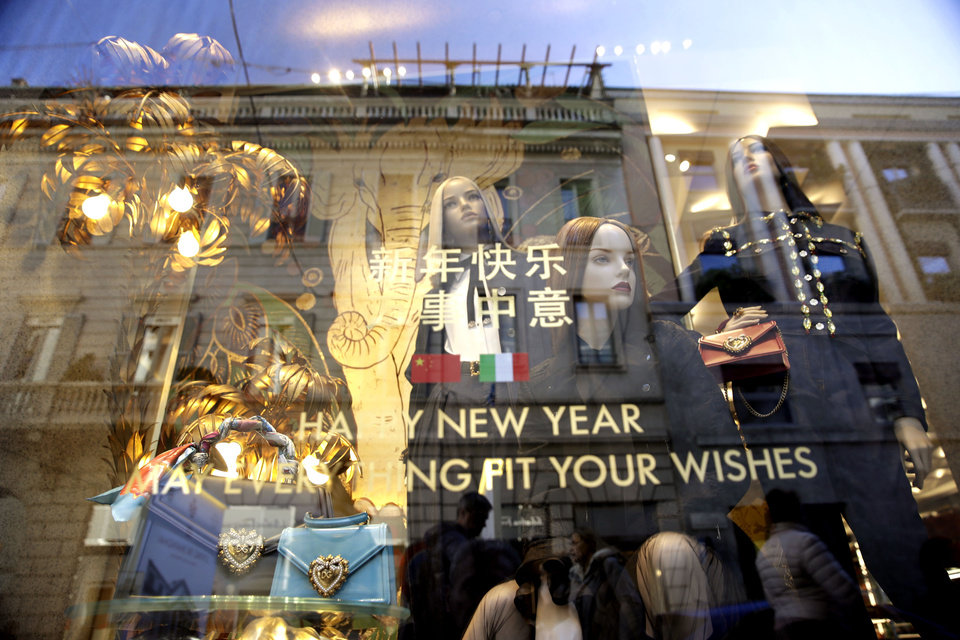 Photo -  Dummies are displayed in a fashion shop at the Montenapoleone shopping district, in Milan, Italy, Tuesday, Feb. 4, 2020. China's virus outbreak is giving global business a chill. In Milan's luxury Montenapoleone shopping district, dozens of luxury brands decked out their windows for Chinese New Year. But wealthy Chinese shoppers, who are responsible for about one-third of all luxury purchases globally, have failed to arrive in their usual numbers. (AP Photo/Luca Bruno)