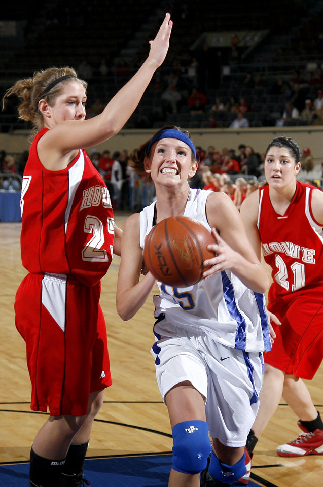 Photo - Newkirk's Hayley Luis (15) goes in for a layup as Howe's Randa Grant (23) and Lynsey White (21) defend her during the girls 2A semi-final between Howe and Newkirk at the State Fair Arena, Friday, March 13, 2009, in Oklahoma City. PHOTO BY SARAH PHIPPS, THE OKLAHOMAN