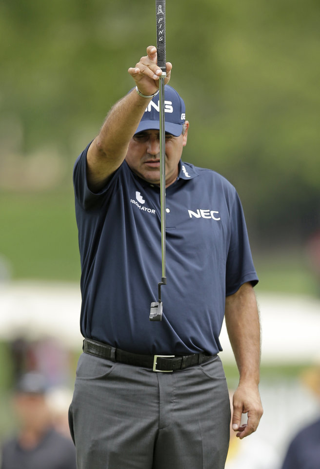 Photo - Angel Cabrera, of Argentina, lines up a putt on the 10th hole during the second round of the Wells Fargo Championship golf tournament in Charlotte, N.C., Friday, May 2, 2014. (AP Photo/Chuck Burton)