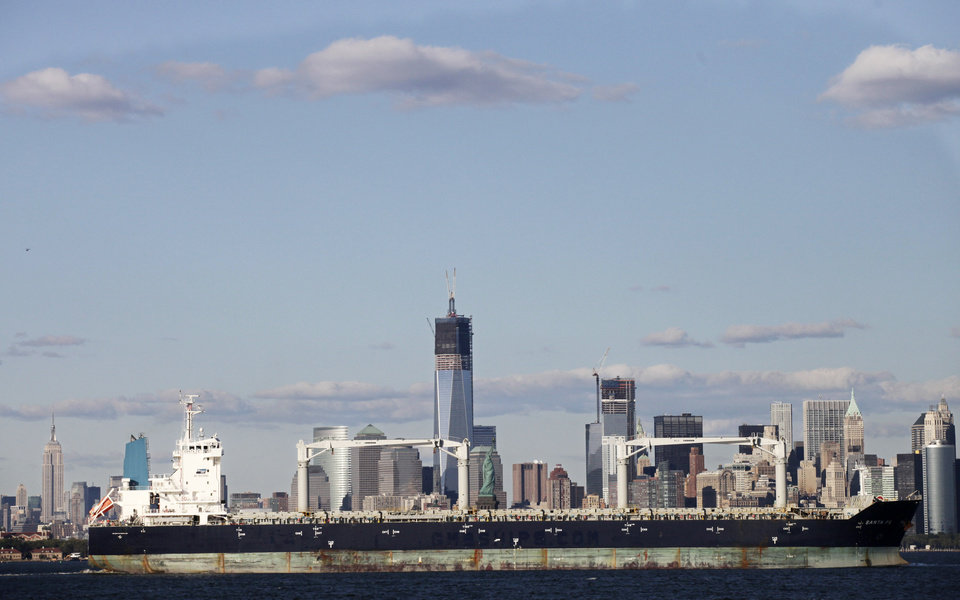 In this photo of Sept. 10, 2012, the cargo ship Santa Fe passes the Statue of Liberty, center, and the New York skyline. The U.S. trade deficit declined to the lowest level in almost two years as exports rose to a record high, a gain that is not expected to last given the global economic slowdown. The trade deficit narrowed to $41.5 billion in September, the Commerce Department said Thursday, Nov. 8, 2012. That is 5.1 percent below the August deficit and the smallest imbalance since December 2010. (AP Photo/Mark Lennihan)
