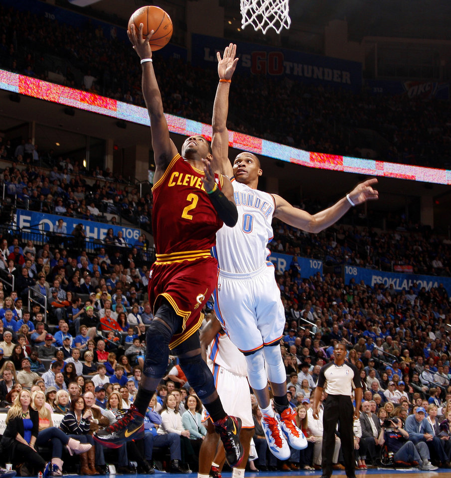 Photo - Cleveland's Kyrie Irving (2) goes past Oklahoma City's Russell Westbrook (0) for a basket during the NBA basketball game between the Oklahoma City Thunder and the Cleveland Cavaliers at Chesapeake Energy Arena in Oklahoma City, Friday, March 9, 2012. Photo by Bryan Terry, The Oklahoman