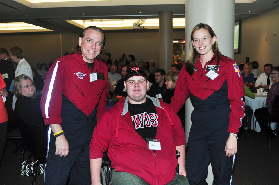 AWARD: Bryce Gannon with Todd Gilbert, EMT-P, and Deven Elliott, RN; both of EagleMed, his flight crew.