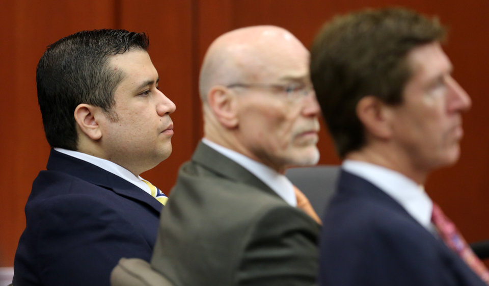 Photo - George Zimmerman, left, sits with his defense lawyers, Don West, center, and Mark O'Mara, during the 15th day of his trial in Seminole circuit court, in Sanford, Fla., Friday, June 28, 2013. Zimmerman has been charged with second-degree murder for the 2012 shooting death of Trayvon Martin.(AP Photo/Orlando Sentinel, Joe Burbank, Pool)