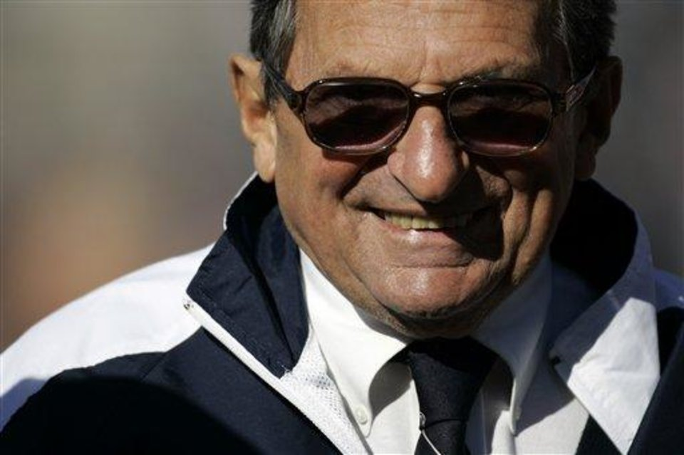 Photo - **FILE** Penn State coach Joe Paterno smiles as he walks the field during warmups before their college football game against Purdue in State College, Pa., in this Saturday, Nov. 3, 2007, file photo. Penn State won 26-19. Penn State head football coach Joe Paterno is being paid about a half-million dollars a year, state officials said Thursday Nov. 29, 2007, ending one of the most closely guarded secrets of college sports in Pennsylvania. (AP Photo/Carolyn Kaster)