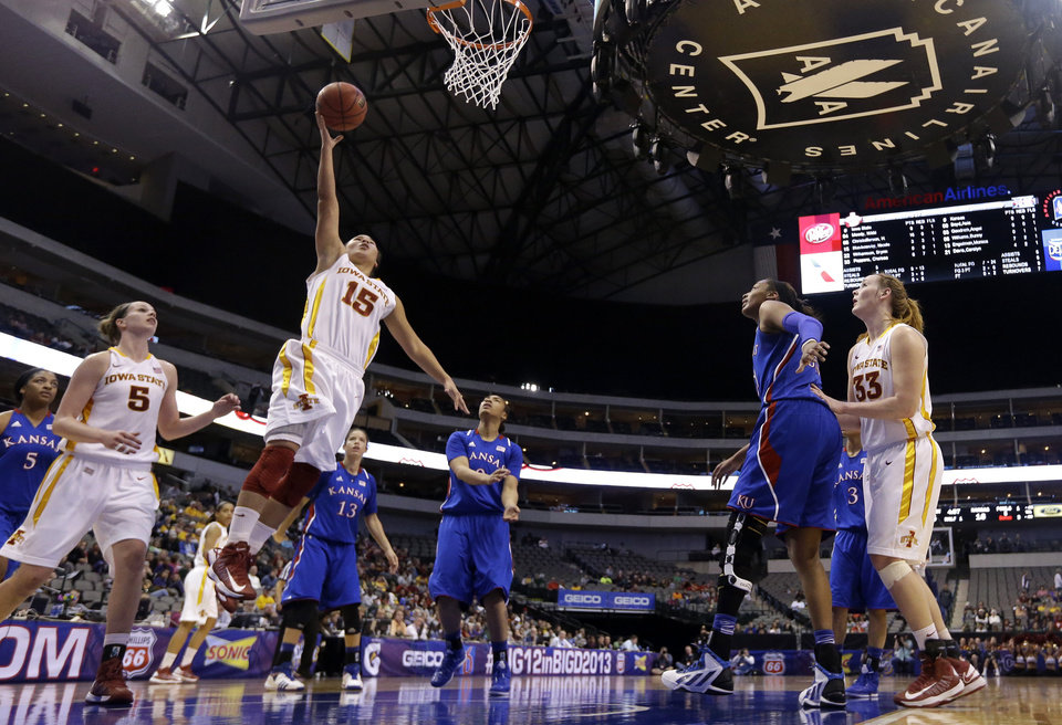 Photo - Iowa State' Nicole (Kidd) Blaskowsky (15) shoots against Kansas in the first half of an NCAA college basketball game in the Big 12 women's tournament on Saturday, March 9, 2013, in Dallas. (AP Photo/Tony Gutierrez)