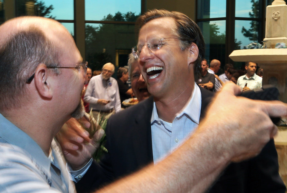 Photo - Dave Brat, right, is congratulated by Johnny Wetlaufer after Brat defeated House Majority Leader Eric Cantor in the Republican primary, Tuesday, June 10, 2014, in Richmond, Va. (AP Photo/Richmond Times-Dispatch, P. Kevin Morley)