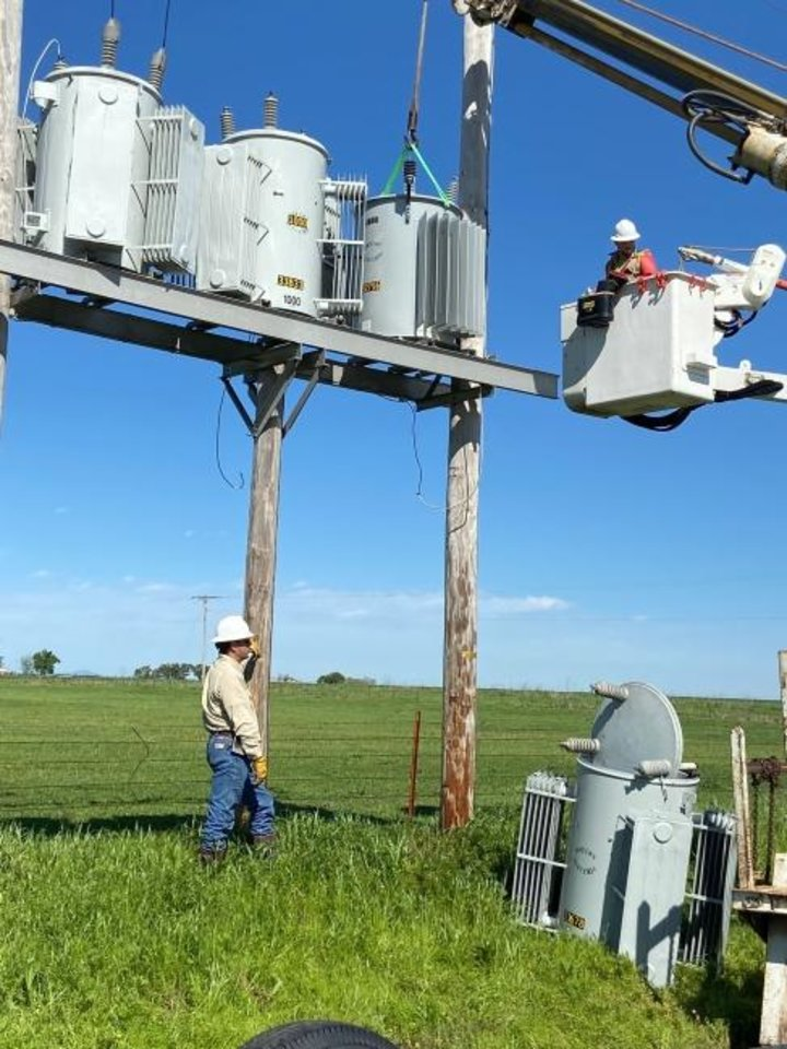Photo -  Cotton Electric Cooperative crew members set a new transformer on one of its circuits. [PROVIDED BY COTTON ELECTRIC COOPERATIVE]