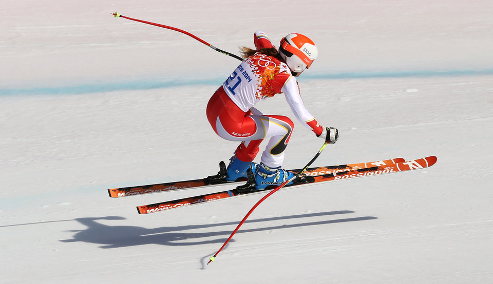 Photo - Canada's Marie-Michele Gagnon makes a jump during the downhill portion of the women's supercombined at the Sochi 2014 Winter Olympics, Monday, Feb. 10, 2014, in Krasnaya Polyana, Russia. (AP Photo/Alessandro Trovati)