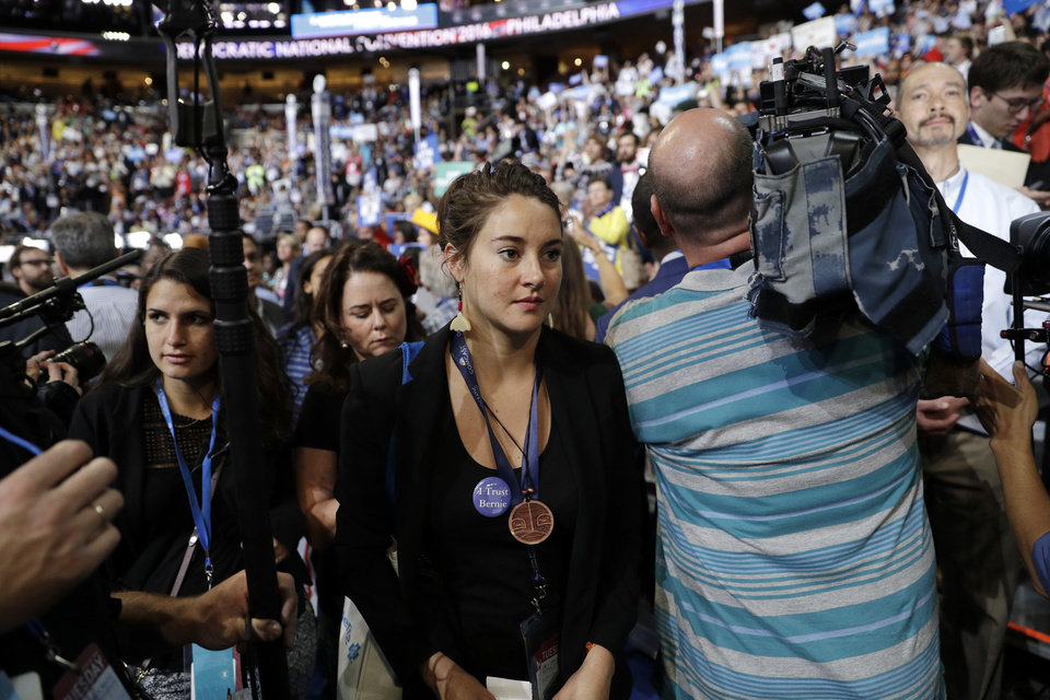 Photo - Actress Shailene Woodley walks around the convention floor during the second day session of the Democratic National Convention in Philadelphia, Tuesday, July 26, 2016. (AP Photo/John Locher)