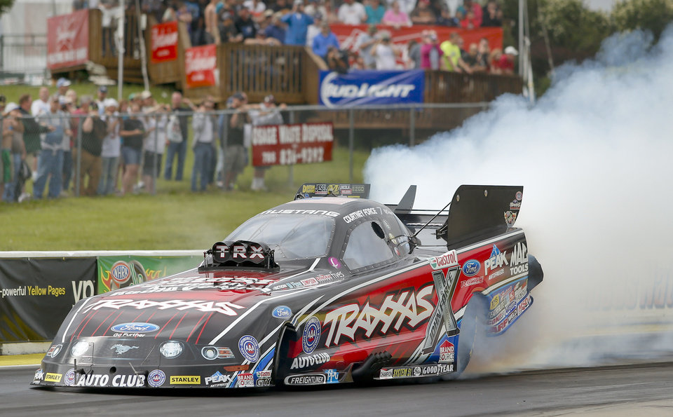 Photo - Courtney Force joins her sister Brittany as one of the top qualifiers at the NHRA Kansas Nationals drag races at Heartland Park in Topeka, Kan., Saturday, May 24, 2015. (AP Photo/Topeka Capital-Journal, Chris Neal)