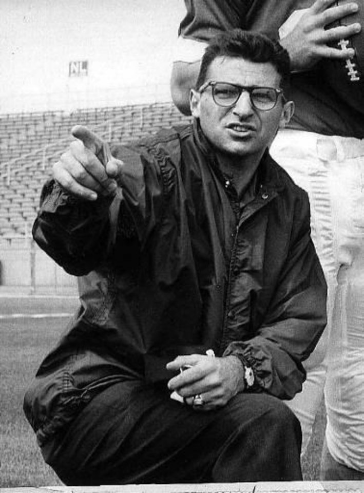 Joe Paterno, associate football coach at Penn state, directs players, Jan. 28, 1965 at State College, Pa. (AP Photo)