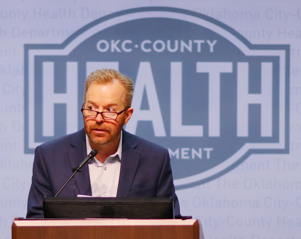 Photo - Dr. Patrick McGough, Executive Director of OKC-County Health Department, talks about the Mayor's declaration of a state of emergency for Oklahoma City after a new case of COVID-19 in the metro area during a press conference at the Oklahoma County Health Department, Sunday March 15, 2020.  [Photo by Doug Hoke/The Oklahoman]