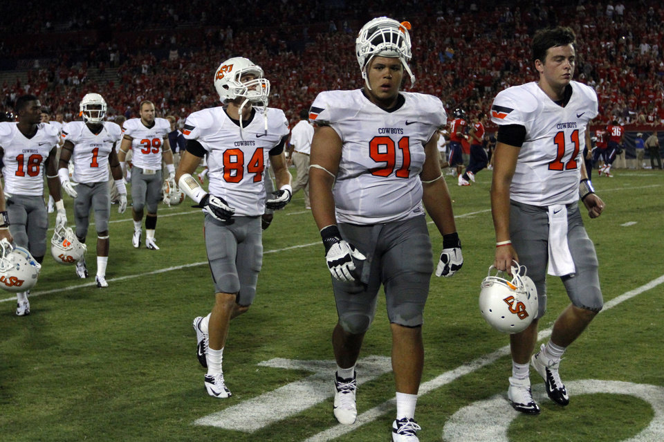 Oklahoma State\'s James Castleman (91) and Wes Lunt (11) walks off the field following the college football game between the University of Arizona and Oklahoma State University at Arizona Stadium in Tucson, Ariz., Sunday, Sept. 9, 2012. Photo by Sarah Phipps, The Oklahoman