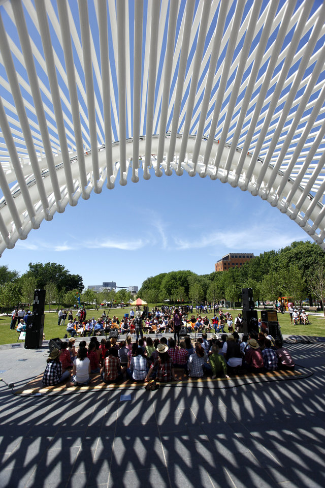 Photo - The Nichols Hills Varsity Choir performs at the Great Lawn Stage during opening day of the Festival of the Arts in downtown Oklahoma City TUesday, April 24, 2012. Photo by Doug Hoke, The Oklahoman