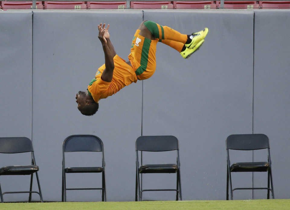 Photo - Zambia's Emmanuel Mayuka does a back flip to celebrate a goal against Japan by teammate Christopher Katongo during the first half of an international friendly soccer match in Tampa, Fla., Friday, June 6, 2014. (AP Photo/John Raoux)