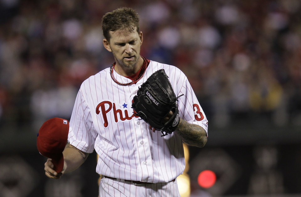 Photo - Philadelphia Phillies' pitcher A.J. Burnett walks off the mound to confer with catcher Carlos Ruiz in the fourth inning of a baseball game against the Washington Nationals, Saturday, May 3, 2014, in Philadelphia. (AP Photo/Laurence Kesterson)