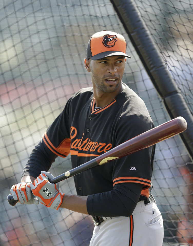 Photo - Baltimore Orioles designated hitter Henry Urrutia prepares for batting practice during a spring exhibition baseball game against the Pittsburgh Pirates in Bradenton, Fla., Monday, March 10, 2014. (AP Photo/Carlos Osorio)