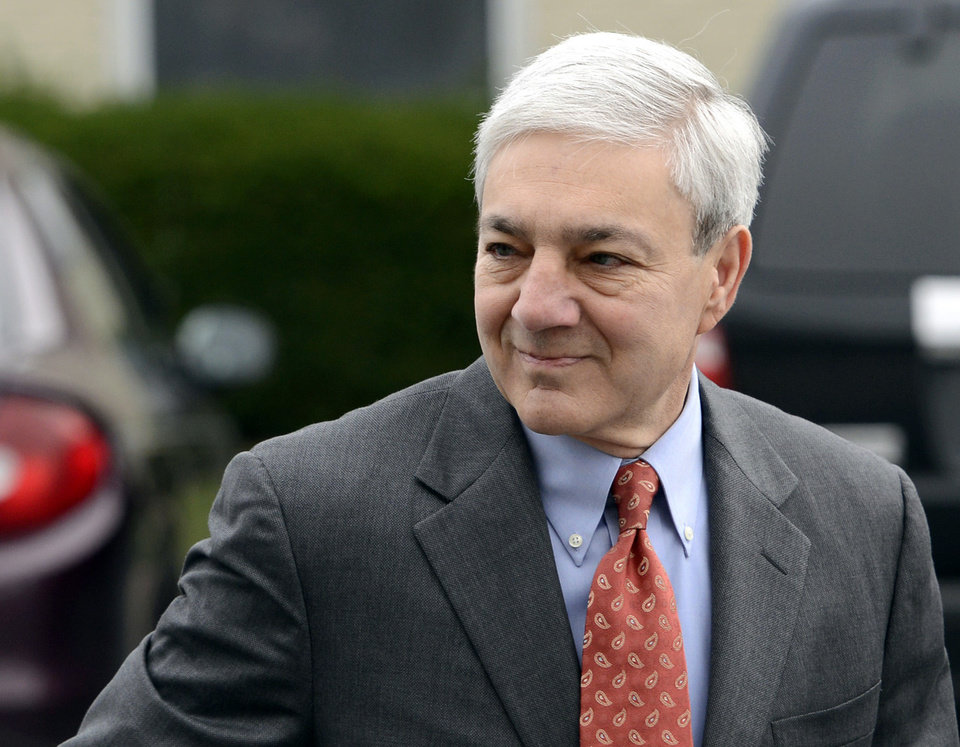 FILE - In this Nov. 7, 2012, file photo, former Penn State president Graham Spanier enters Harrisburg District court in Harrisburg, Pa., to be arraigned on charges he lied about and concealed child sex abuse allegations involving former assistant football coach Jerry Sandusky. Spanier earned $2.5 million in severance last year, the school said Wednesday, Nov. 28, 2012. Spanier was forced out of the job after Sandusky was arrested on child molestation charges, but remains a tenured faculty member currently on leave. (AP Photo/Jason Minick, File)