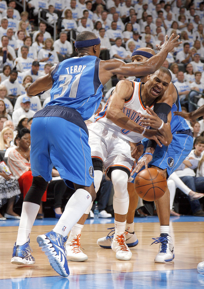 Oklahoma City\'s Russell Westbrook (0) tries to pass around Dallas\' Jason Terry (31) and Vince Carter (25) during Game 2 of the first round in the NBA basketball playoffs between the Oklahoma City Thunder and the Dallas Mavericks at Chesapeake Energy Arena in Oklahoma City, Monday, April 30, 2012. Photo by Sarah Phipps, The Oklahoman