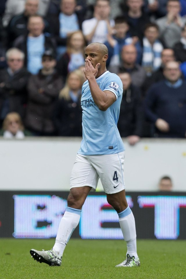 Photo - Manchester City's Vincent Kompany walks from the pitch after being sent off during his team's English Premier League soccer match against Hull City at the KC Stadium, Hull, England, Saturday March 15, 2014. (AP Photo/Jon Super)
