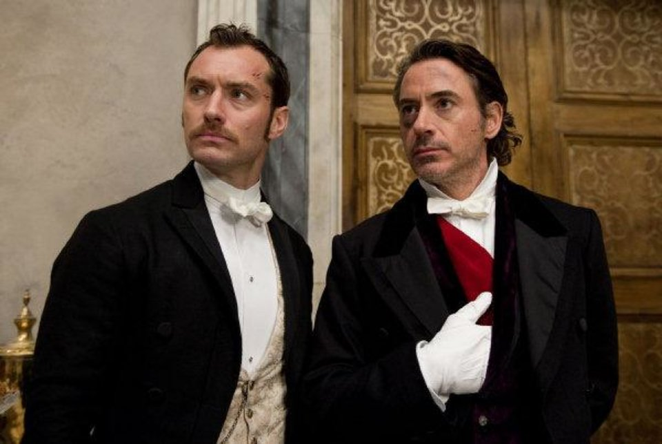Jude Law, left, as Dr. James Watson and Robert Downey Jr. as Sherlock Holmes in