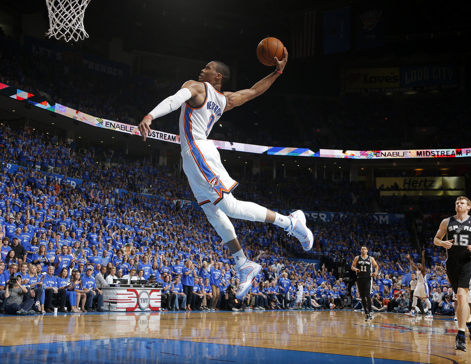 Oklahoma City's Russell Westbrook (0) attempts a dunk during Game 3 of the Western Conference Finals in the NBA playoffs between the Oklahoma City Thunder and the San Antonio Spurs at Chesapeake Energy Arena in Oklahoma City, Sunday, May 25, 2014. PHOTO BY BRYAN TERRY, The Oklahoman