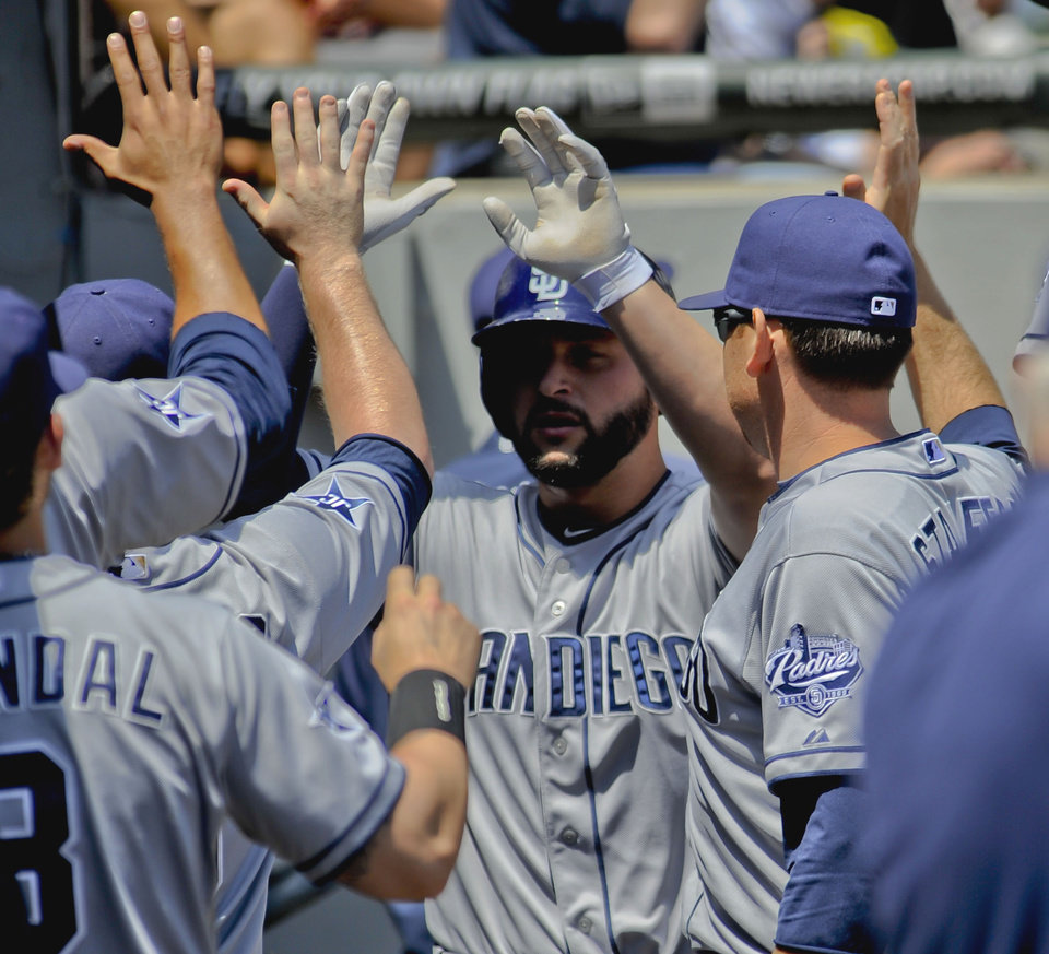 Photo - San Diego Padres' Yonder Alonso scores off of a Will Veneble double during the second inning of a baseball game against the Chicago White Sox on Saturday, May 31, 2014, in Chicago. (AP Photo/Matt Marton)