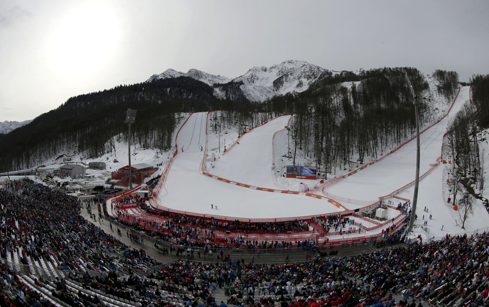 Photo - In this photo taken with a fisheye lens, the Rosa Khutor Alpine center is seen during the men's downhill event at the 2014 Winter Olympics, Sunday, Feb. 9, 2014, in Krasnaya Polyana, Russia. (AP Photo/Charlie Riedel)