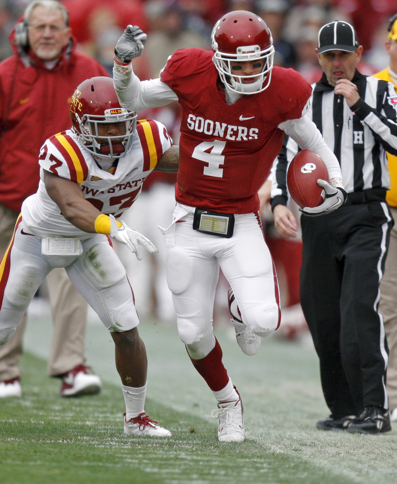 Photo - Oklahoma's Kenny Stills (4) is pushed out by Iowa State's Leonard Johnson (23) during a college football game between the University of Oklahoma Sooners (OU) and the Iowa State University Cyclones (ISU) at Gaylord Family-Oklahoma Memorial Stadium in Norman, Okla., Saturday, Nov. 26, 2011. Photo by Bryan Terry, The Oklahoman