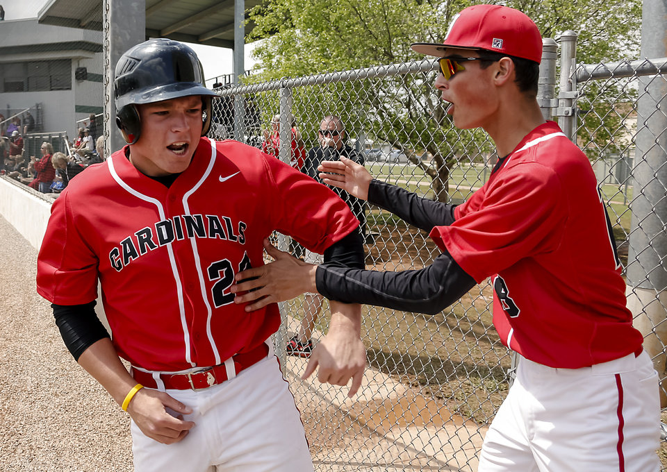 Verdigris' Tanner Smith reacts with teammate Nathan Nadal (18) after scoring a run during the 3A baseball semifinal game between Verdigris and Spiro on Friday, May 10, 2013, in Edmond, Okla.Photo by Chris Landsberger, The Oklahoman
