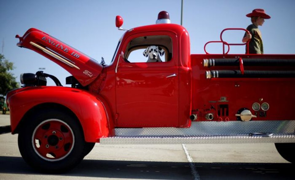 Photo -  UCO: Zachary English, 8, stands in the bed of a 1945 Ford fire truck during the LibertyFest car show on the University of Central Oklahoma campus in Edmond, Okla., Saturday, June 26, 2010.  Photo by Bryan Terry, The Oklahoman ORG XMIT: KOD