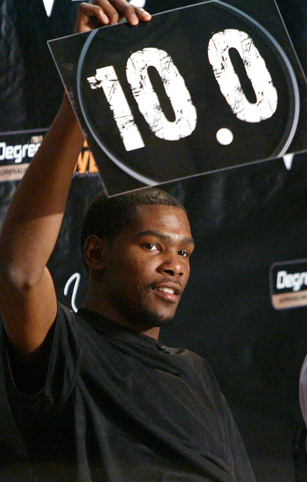 Kevin Durant holds up a score during filming of the Degree Men Alley-Oop Challenge at the Santa Fe Family Life Center on Monday. PHOTO BY JOHN CLANTON, THE OKLAHOMAN