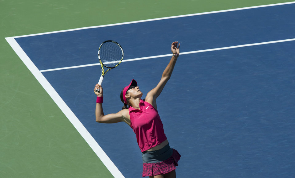 Photo - Caroline Garcia, of France, serves to Angelique Kerber, from Germany, during second round play at the Rogers Cup tennis tournament Wednesday, Aug. 6, 2014 in Montreal. (AP Photo/The Canadian Press, Paul Chiasson)
