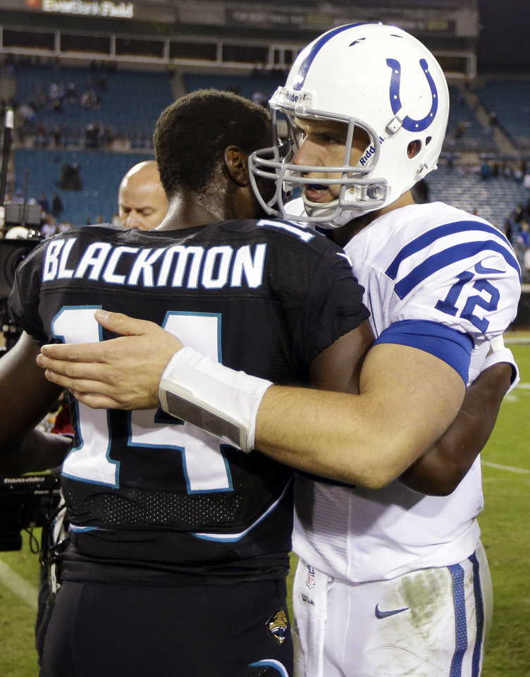 Photo -   Indianapolis Colts quarterback Andrew Luck (12) hugs Jacksonville Jaguars wide receiver Justin Blackmon (14) after the Colts' 27-10 win in an NFL football game, Thursday, Nov. 8, 2012, in Jacksonville, Fla. (AP Photo/Chris O'Meara)
