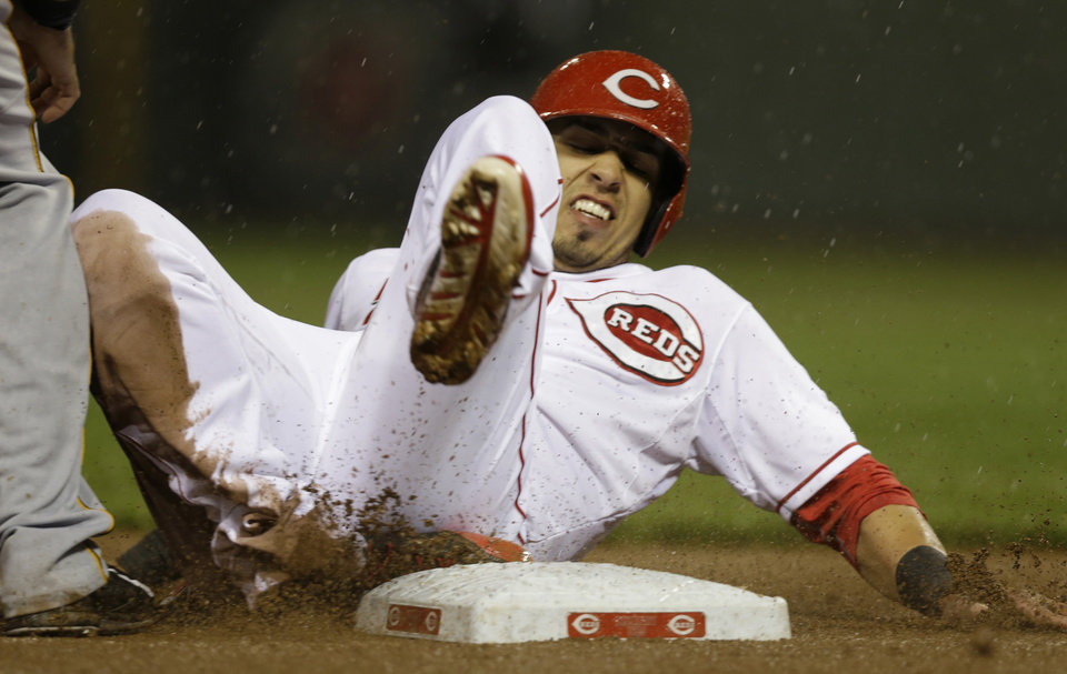 Photo - Cincinnati Reds' Neftali Soto advances to third on a sacrifice fly by Billy Hamilton in the fifth inning of a baseball game against the Pittsburgh Pirates, Monday, April 14, 2014, in Cincinnati. (AP Photo/Al Behrman)