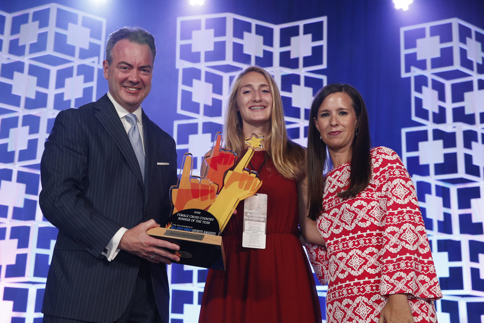 Photo - Oklahoman Publisher Chris Reen and sports columnist Jenni Carlson present the female cross country athlete of the year award to Emma Downing at the Oklahoman's All-City Prep Sports Awards, celebrating top high school athletes, at the Cox Convention Center on Tuesday, June 26, 2018 in Oklahoma City, Okla.  Photo by Steve Sisney, The Oklahoman